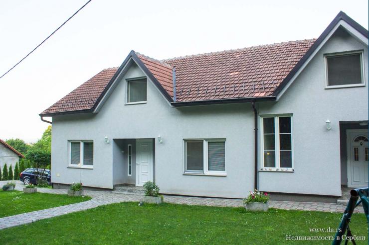 Новый дом с большим садом на 2 семьи в Лозницe