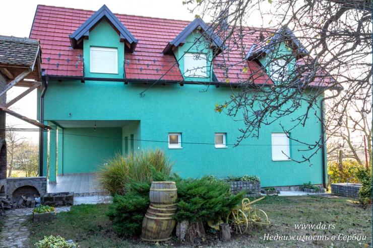 Новый дом с садом в пригороде Лозницы